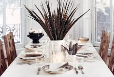Modern Thanksgiving Tablescape — flower-free centerpiece using pheasant feathers from Domino.