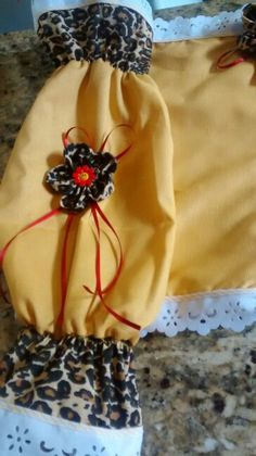 Jogo de cozinha, caramelo com flor de oncinha