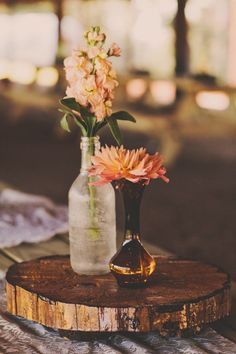 Texas Hill Country wedding... Nicee center piece idea with bottles and mason jars!