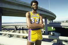 In Kareem Abdul-Jabbar's 14 season with the Lakers he averaged a double-double six times and scored 20 points per game or better in all but his final three seasons. The NBA's all-time leader in points won three MVPs and five championships in Los Angeles. Nba Players, Basketball Players, College Basketball, Norm Nixon, George Mikan, Moses Malone, Hakeem Olajuwon, England Fans
