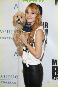bella thorne jacob latimore move your body 16, Bella Thorne holds onto pup Kingston as she arrives at the WAT-AAH! Foundation Move Your Body 2013 Flash Workout held at The Avenues World School on Wednesday afternoon…