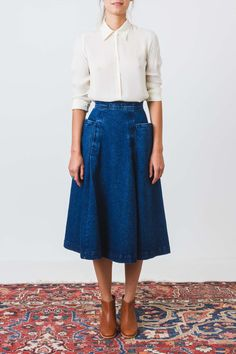 Midi length, A-line denim skirt in premium washed denim with front pleats and voluminous side pockets. Fits at the waist and flares out to hem. - Sits high on waist - Hidden back zip and hook and bar #denimskirt