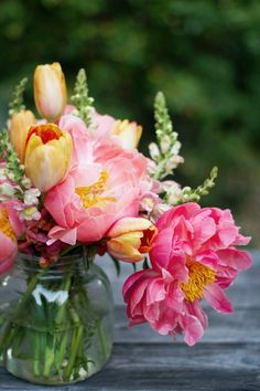 Peonies, tulips and snapdragons in hot pinks and oranges create a cheerful bouquet
