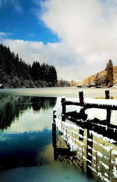 A lovely wooden snow covered jetty by the shores of Loch Ard in Winter at Loch Lomond and the Trossachs National Park, Scotland     |    19 Reasons Why Scotland Must Be on Your Bucket List. Amazing no. #12