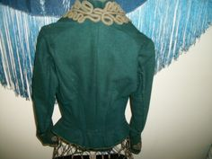 Late 1880s/early 1890s green wool with yellow silk, back