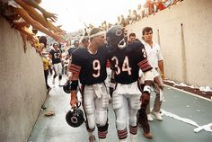 Jim McMahon and Walter Payton leave the field after the Bears' 38-28 victory over Tampa Bay in the 1985 season opener at Soldier Field. #chicagobears #1985