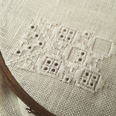 Doing whitework embroidery on the train to London. Listening to Björk's latest album, which is a perfect companion for this type of work I think!