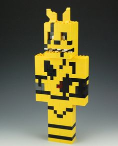 Lego Five Nights at Freddys Golden Bonnie. This creation is 13 inches tall, 5 inches wide and 2 1/2 inches deep.