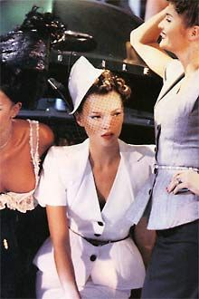 """Kate Moss, super chic in a neo-fifties cotton pique toque with duck quills in the legendary Pin-up studio show."""