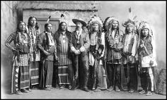 Buffalo Bill at 1901 Indian Congress. Left to right 1 - Brave Chief 2 - Eagle Chief 3 - Knife Chief 4 - Young Chief 5 - Buffalo Bill 6 - American Horse 7 - Rocky Bear 8 - Flys Above 9 - Long Wolf.