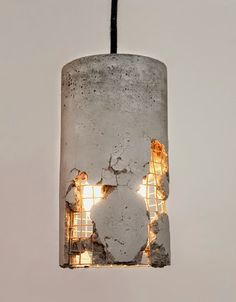 Pendant light with broken concrete creates the illusion of a building falling apart. #lighting #lightingdesign