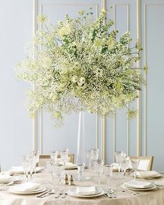 Super affordable & economical DIY centerpiece with lots of wow factor, would be just as pretty for a formal, or casual fete. Miniature daisies, doily-shaped Queen Anne's lace, and baby's breath come together in a beautiful balancing act atop a tall, graceful candlestick.