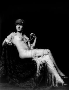 Alice Wilkie, Ziegfeld girl, by Alfred Cheney Johnston, ca. 1925           From the Page: Alice Wilkee  (probably spelled Wilkie), full length portrait, seated, facing  slightly left in semi-nude provocative pose, photo by Alfred Cheney  Johnston for Ziegfeld Follies, ca. 1925 (1930 according to the Library  of Congress photo description, but she only performed for the Follies  from 1924 to 1926).
