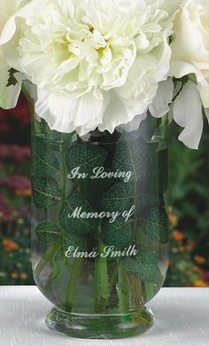 This 8 x 5 custom engraved glass memorial flower vase will celebrate the memory of your deceased loved ones, at your wedding ceremony and every day thereafter. Fill your personalized memorial vase with flowers that will bloom with love and fond memories of a family member or special friend unable to attend your wedding in body but forever with you in spirit.