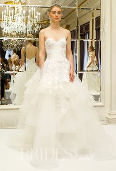 Marchesa - Spring 2016. Strapless tulle ball gown wedding dress with a sweetheart neckline, tiered handkerchief drape skirt and floral threadwork embroidery, Marchesa