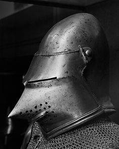Armor, ca. 1400–1450 and later, Italian; Was assembled & restored under Dr. Bashford Dean (1920s). Elements mostly from Chalcis. Intent: present a full armor of the style worn about 1400, a period from which no complete armors survive. (...) Portions of the brass at the top edge of the left cuisse (thigh defense), the lower edges of the right greave (lower leg defense), and the visor are genuine; the remainder of the brass is restored. The helmet, a visored bascinet, is not from Chalcis.