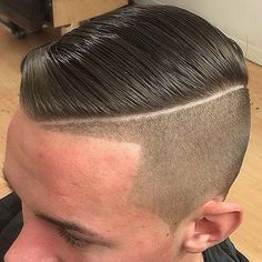 Undercut Fade with Part and Slicked Comb Over