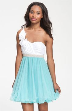 Way-In One Shoulder Rosette Colorblock Dress (Juniors). Delicate rosettes accent the asymmetrical-shoulder design of a pleated bodice. A ruffle-hem skirt, glittering rhinestone belt and bow detail at the back waist all add to the flirty, feminine styling.