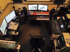 Bill Feduska's studio 'MindBomb Studio, 4k editing on the right, music production in the center, Midas console on the left links it together. HP Z800 processing, B&W PM1 monitors with Classe amp'