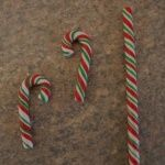 """Here is a super easy way to make fun Holiday Candy Canes or Lollipops for gifts, packages or your own tree!  I used Premo clays in Frost White Glitter, Pomegranite, and Green. Condition your Frost White Glitter clay really well and then roll out a longsnake maybe 5"""" or so about 3/4"""" thick. Next"""