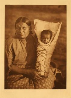 *A Comanche Mother (This is made of bark and not typical of Comanche cradle boards)