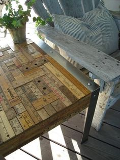 I've been begging Donald to use our scrap floor wood to make a table, but this idea is pretty cool too.  Maybe I can mix and match?  Floor wood in creative ruler-like pattern?