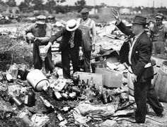Back in prohibition days, liquor-dumping expeditions were everyday affairs. For the first time since the repeal, state agents dumped liquor at the east Omaha dump at 11th and Cottonwood in June 1938. It was seized in raids on places which had no authority to sell it. The liquor had been kept in a courthouse vault until cases involved were disposed of. THE WORLD-HERALD