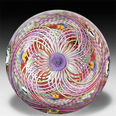 """Mike Hunter 2014 white, pink, purple, green and brown double latticinio swirl with silhouette canes, flowers and clown faces crown paperweight. Edtion #1 of 1. Signature cane. Signed/dated. Diameter 3 1/4""""."""