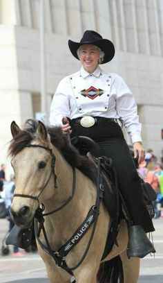 Houston Mayor Annise Parker rides a police horse during the 76th Annual Houston Rodeo Parade. Follow our RodeoHouston coverage at Chron.com/rodeo.