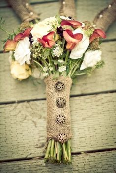 Burlap-wrapped flower bouquets with button accent. colors and textures mmm ya this is a very cute idea, bleached burlap maybe?