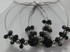 """Basketball wives inspired hoop earrings in black and silver beads. Large hoops measure 2-1/2"""".  $2.00  Available at www.blingychics.com"""