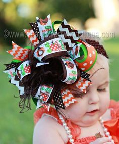 A cute and cheeky Thanksgiving holiday season hair bow with a sense of humor to boot! Turkey Gobble ribbons and brown and orange zigzag and polka dot patterned loops gather in a fun fall over the top bow headband for babies with brown ostrich feathers and rhinestones to finish. Hues of chocolate, lime, and tangerine make this autumn hair bow for babies an unusual collectors item. Ideal for Thanksgiving and Fall Festivals.  This is an original creation by Beautiful Bows Boutique