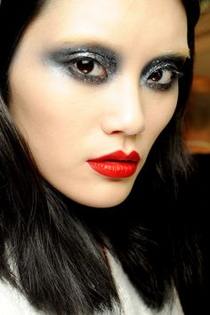 SPRING/SUMMER 2010 COUTURE - Dramatic glittery smoky eyes were paired with red lips at Givenchy. Pat McGrath