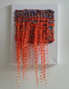 Lengths of yarn left hanging on front of weave. This may be useful in my project as a way of depicting rust breaking away from the surface, perhaps with different sized yarns joined through the weave Weaving Textiles, Weaving Art, Tapestry Weaving, Loom Weaving, Hand Weaving, Textile Fiber Art, Weaving Projects, Woven Wall Hanging, Fabric Manipulation