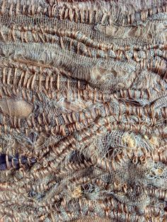 Julia Wright hand stitch layered fabric with rust dyed fabric
