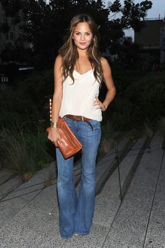 Love the beachy hair and sleek hippy look! Chrissy Teigen @ Coach High Line Party