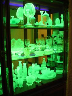 Vaseline glass collection under black light.