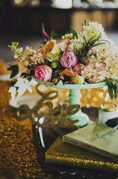 glam centerpiece, photo by Ariel Renae, styling by Juli Vaughn http://ruffledblog.com/peach-and-gold-georgia-wedding #centerpieces #weddingideas #reception
