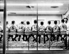 photo idea.  Get the team to sit on top of bleachers.
