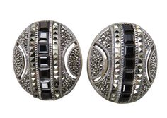 Crafted with artisan workmanship and intricate detail, these handsome Judith Jack clip earrings lend an abstract design in sterling silver with marcasite and onyx accents, easily coordinate with any outfit and accessories.