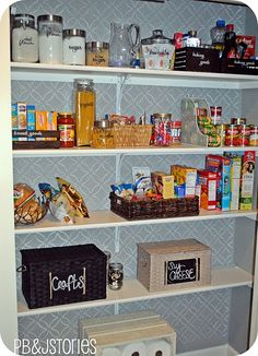 Really like this kitchen pantry redo - they painted and stenciled the back wall of the pantry.  Organized all food with labels on containers.