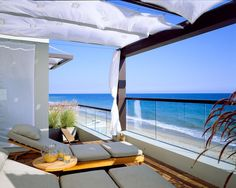 Contemporary Beach House Home Design // patio decor // glass balcony // overlooking ocean // coastal style