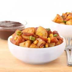 Sweet and tangy Apple Butter BBQ Potato Salad tossed with bacon, corn, and scallion will be the winning side dish at your next picnic.