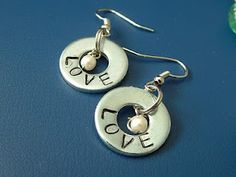 Stamped washer jewelry. As though I need more projects on hand... I just bought the steel stamping set!