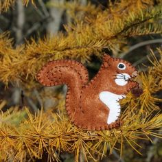 Bring the joy of the Maine woods indoors with this darling red squirrel pattern. He's perfect for your Christmas tree.
