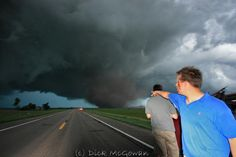 Reed Timmer & his team after a close call. . .  Amazing photo though.
