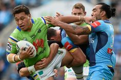 Josh Papalii of the Canberra Raiders is tackled during the round 16 NRL match between the Gold Coast Titans and the Canberra Raiders at Cbus Super Stadium on June 26, 2016 in Gold Coast, Australia.