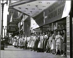 """Teenage girls wait in line for a fashion show presented by """"Seventeen Magazine"""" and Hart's Department Store in San Jose, CA, circa 1950s. I love this picture! These are the types of clothes and flat shoes we wore when I was a young girl. And, if you'll notice the hairdos, this was before we all started """"ratting"""" (back-combed) our hair, to make it bigger."""