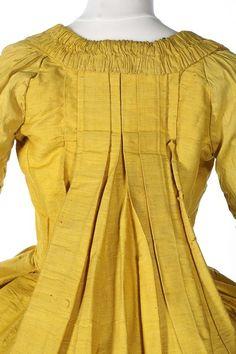 A brilliant yellow bourette silk robe à la Française, circa 1760-70, with r