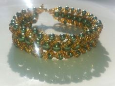 green and gold bracelet by tahdeah on Etsy, $5.00
